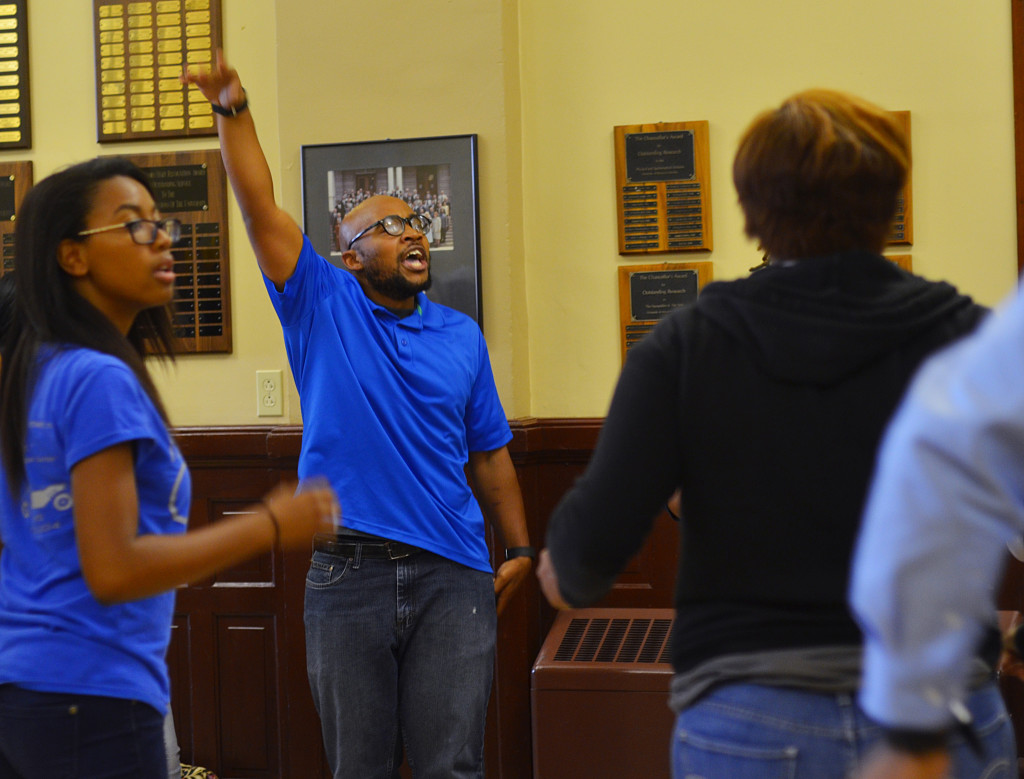 Graduate student Jonathan Butler leads the protestors in a chant in Jesse Hall at the University of Missouri in Columbia, Missouri, on Tuesday, Oct. 6, 2015. (KOMUNews image via Creative Commons license.)